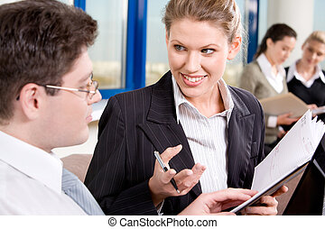 Discussion - Portrait of business people chatting in the...