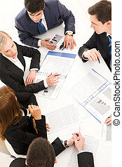 Discussion - Above view of young co-workers working with...