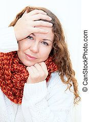 Diseased cold woman in a red scarf and sweater, white background