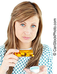 Diseased woman taking pills