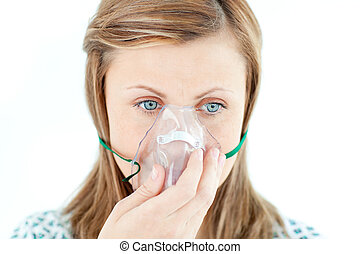 Diseased young woman wearing a mask