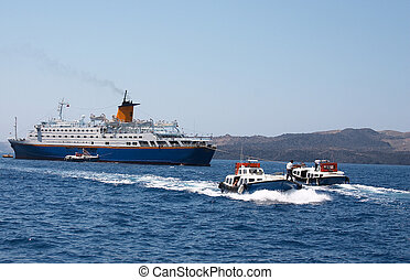 Disembarking at Fira - A cruise liner offloading passengers ...