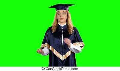 Disgruntled graduate threatening finger. Green screen
