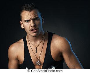 disgruntled man on black background
