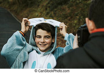 disguised as posing for the photographer smiling boy