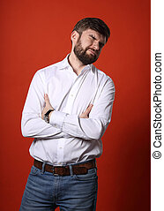 Disgusted bearded business man with closed eyes and unhappy ...