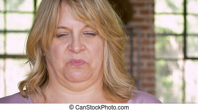 Disgusted or nauseous feeling woman on the verge of vomiting
