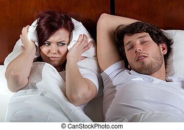 Disgusted wife and sleeping husband