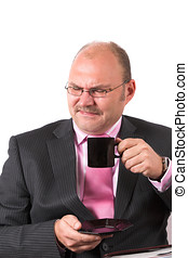 Disgusting coffee - Businessman pulling a face full of...