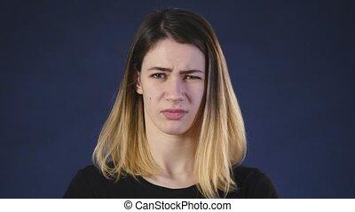 disgusting emotion. girl on dark background - disgusting...