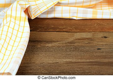 Dish cloth in yellow and white on brown wooden table