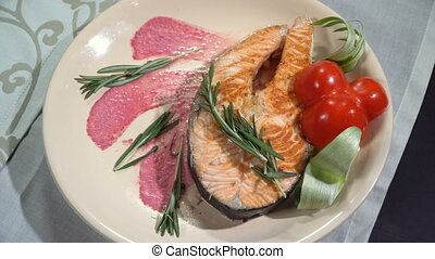 Dish fried red fish steak in a restaurant - A dish of...