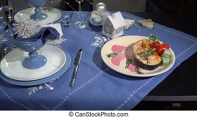 Dish fried red fish steak in a restaurant - Christmas table...