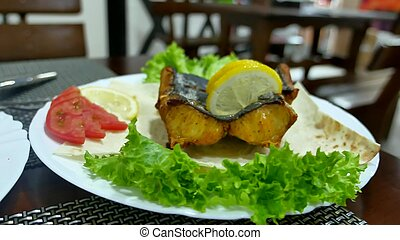 Dish of fish. Fried shark eating on a plate with lemon. Lunch at the cafe restaurant