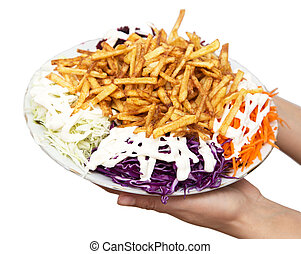 dish of fries with mayonnaise and vegetables on a white background