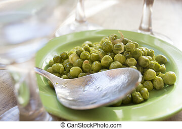 dish of green peas enclosed from glasses
