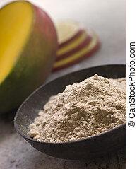 Dish of Mango Powder with sliced Fresh Mango