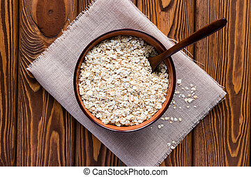Dish of oatmeal with a spoon on a napkin