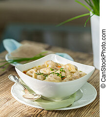 Dish of savory pork tortellini in broth pelmeni russian -...