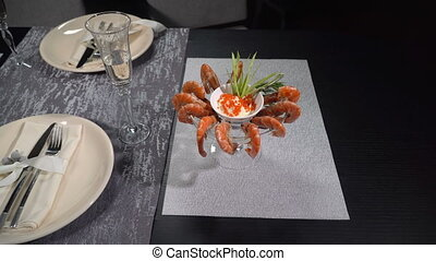 Dish of shrimp on a table in a restaurant - Dish of shrimp...