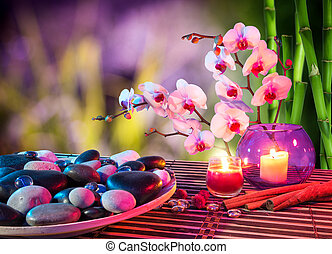 dish of stones massage with orchids