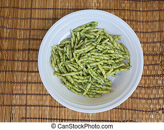 dish of trofie al pesto: handmade pasta with basil sauce -...