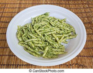 dish of trofie al pesto: handmade pasta with basil sauce