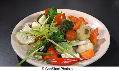 Dish of vegetable stew on the table - Cooked dish of...