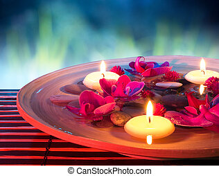 dish spa with floating candles