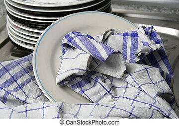 Dishes wiped with white blue checked dishtowel