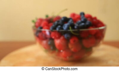 Dish with blueberries, raspberries and strawberries...