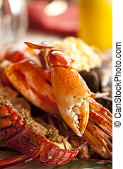 Dish with cooked crabs and lobsters with selective focus on...