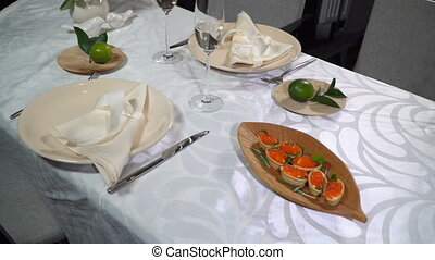 Dish with red caviar on the holiday table