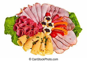 Dish with sliced ham, cheese and salami rolls, boiled eggs ...