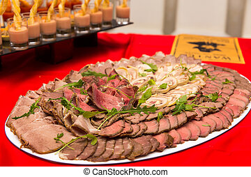 Dish with sliced meat products on the festive table