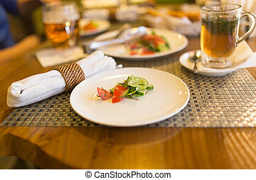Dish with tomatoes and cucumbers in a restaurant