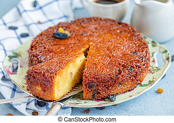 Dish with traditional dessert of baked noodles. - Piece of...