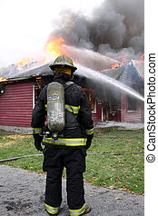 Disheartened Fireman - Disheartened fireman in front of a...