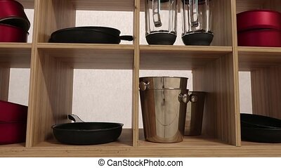 dishes in the kitchen - Slowly, close, the cart moves past...