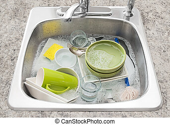 Spoons and fork on dirty dishes in the kitchen sink .... stock ...