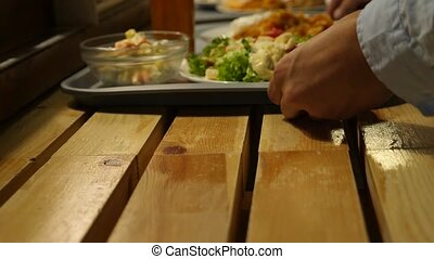 dishes with food on a tray in the dining room self-service....