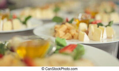 Dishes with sophisticated cutting of elite cheese with mint,...