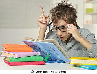 Disheveled boy wearing glasses