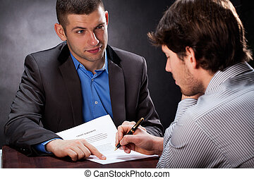 Dishonest businessman convincing his client to sign a...
