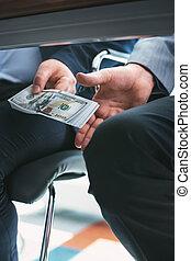 Dishonest rich businessman giving a bribe