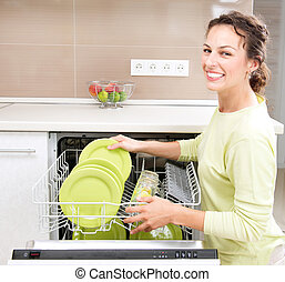 dishwasher., 若い女性, 台所で, すること, housework., wash-up