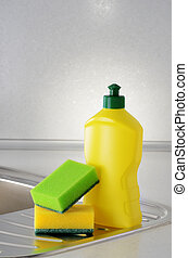 Dishwashing liquid with a sponge on kitchen sink