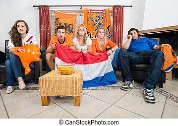 Disillusioned Dutch sports fans watching their national team...