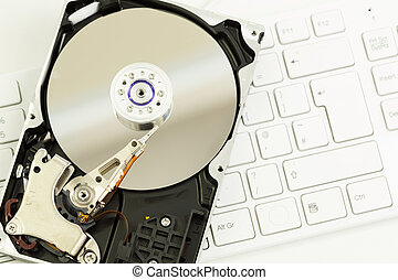 Disk drive on a keyboard - Disk drive on a clean white...