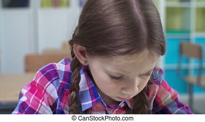 Close up of school girl frustrated from lesson